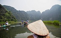 Vietnam, Ninh Binh, Young tourist on river boar in Tom Coc