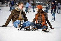 Couple falling while ice skating