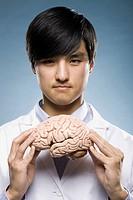 scientist holding a brain