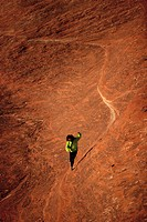 High angle view of a person walking on a rock formation