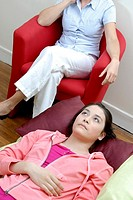 Psychotherapy  Client on a sofa talking to her therapist
