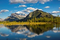 Mount Rundle and Sulphur Mountain reflected in the Vermilion Lakes in the town of Banff in Banff National Park in the Canadian Rockies in Alberta Cana...