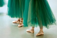 Performing ballerinas in green tutus