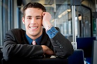 Portrait of a young man sitting in a commuter train
