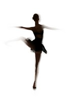 Silhouette of a female ballerina standing on one leg