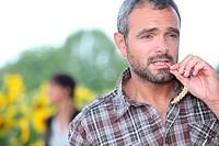 Farmer chewing a piece of grass