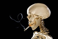 Profile of skeleton smoking cigarette