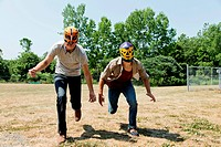 Two young men wearing wrestling masks