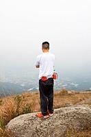 Asian man hiking in mountains