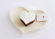 Heart_shaped chocolate cake and a message card