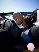 African_American newlywed couple in convertible car