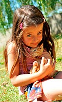little girl and kitten
