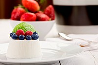Panna cotta with Berries on white table