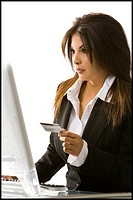 Woman using her credit card on her computer