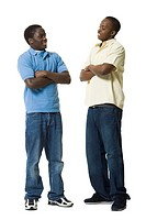 Two African_American brothers posing with arms folded