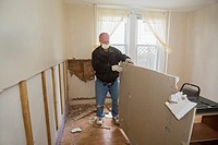 Atlantic City, New Jersey - Bill Carmen, a volunteer from New Covenant Community Church, strips drywall from the home of a low-income family that was ...