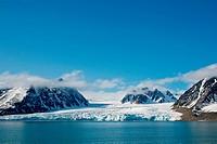 Beautiful Monacobreen glacier in Liefdefjorden, northwest coast of Svalbard, Norway, in summertime.