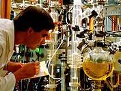 A researcher at a thin_film evaporator facility.