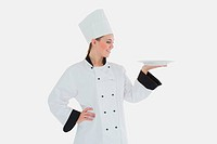 Female chef looking at plate
