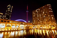 View of the Rogers Centre and the CN tower looking north from Queen´s Quay West in downtown Toronto, Ontario