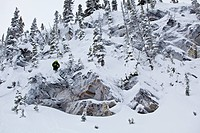 A male skier catches some air off a cliff at Revelstoke Mountain Resort, Revelstoke, BC