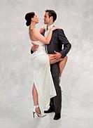 fashion couple dancing , studio shot