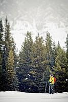 A young man snowshoeing at Peter Lougheed Provincial Park, Kananaskis, AB