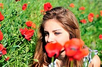girl through high poppies