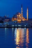 The New Mosque with Nuruosmaniye at twilight early morning with lights reflected in the Golden Horn Istanbul