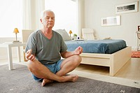 Senior man meditating