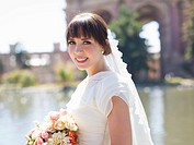 Portrait of young bride in park