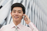 Chinese businessman talking on cell phone