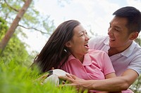 Chinese couple playing with soccer ball