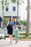 Caucasian mother and daughter walking together