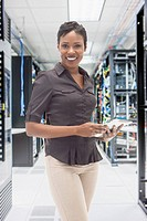 African American businesswoman in server room