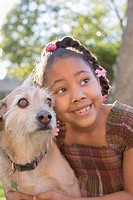 African American girl hugging dog