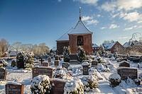Snow covered Carolinensieler Kirche Carolinensieler Church with graveyard in Carolinensiel, Lower Saxony, Germany, Europe