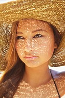 Portrait of a young woman wearing a sunhat, kauai hawaii united states of america