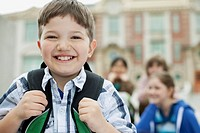 Portrait of male, elementary student going back to school.