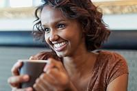Pretty African American woman enjoying a cup of coffee.