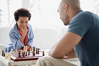 Father and son enjoying a game of chess.