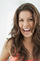 Portrait of pretty Latin American woman with big smile.