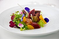 Salad with duck breast garnished with flowers