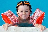 boy learning to swim