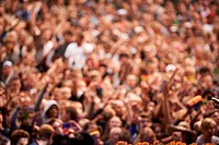 Devoted rock fans at a concert with their hands raised