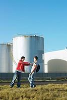 Teenage boys fighting in an empty lot