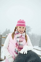 Girl holding snow tube