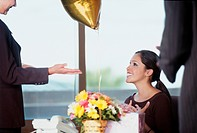Businesswoman Receiving Gifts at Her Desk