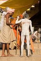 Hindu saint naga baba Shivdasgiri in Varanasi on Ganga river ; Uttar Pradesh ; India