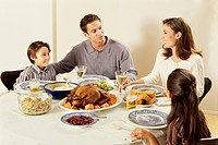 Portrait of a family eating Thanksgiving dinner together